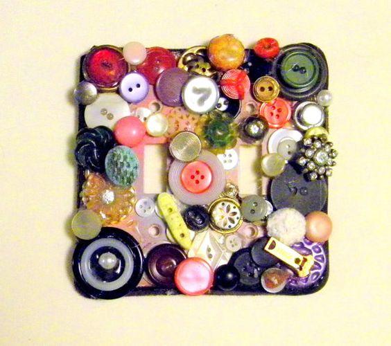decorar enchufes con botones